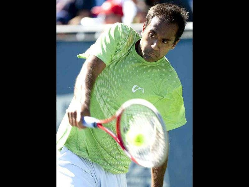 Rajeev Ram returns the ball during a match against Paul Capdeville, of Chile, at the Farmers Classic tennis tournament at University of California Los Angeles in Los Angeles. AP/Grant Hindsley
