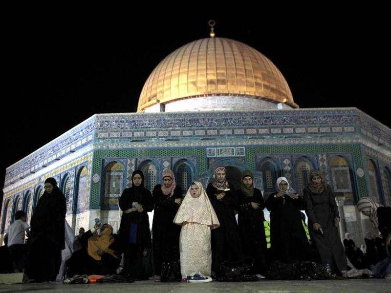 Palestinian women pray in front of the Dome of the Rock, at the compound known to Muslims as Noble Sanctuary and to Jews as The Temple Mount in Jerusalem's Old City during the holy month of Ramadan. Reuters/Ammar Awad