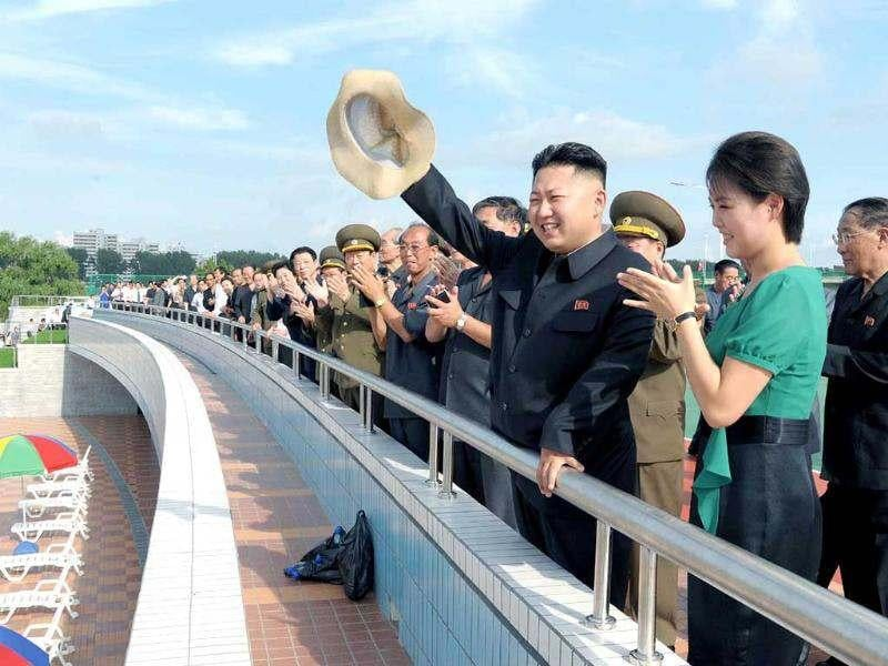 North Korean leader Kim Jong-Un accompanied by his wife Ri Sol-Ju waves to the crowd at the Rungna People's Pleasure Ground in Pyongyang. AP/Korea News Service