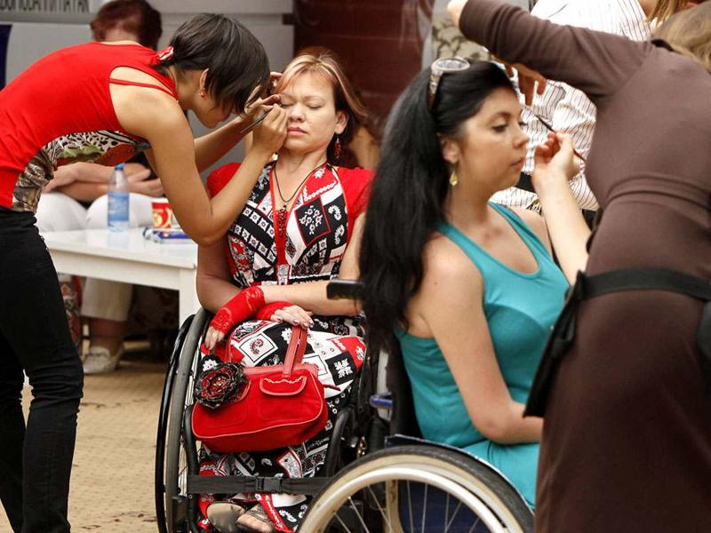 Make-up artists work on models with physical disabilities before a 'Fashion week chance' show in Kiev. Ukrainian fashion designers presented haute couture collections for women with physical disabilities at a special show in Kiev. REUTERS/Gleb Garanich