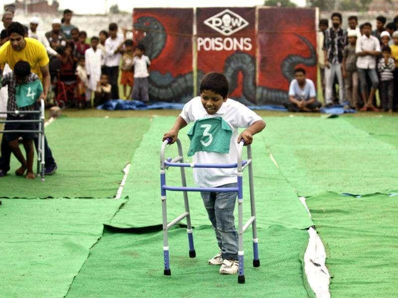 A boy suffering with birth defects competes in a race during a Special Olympics held by the survivors of the deadly 1984 Bhopal gas leak in an effort to shame Olympic sponsor Dow Chemical Co. on the eve of the London Games in Bhopal. AP photo/Altaf Qadri