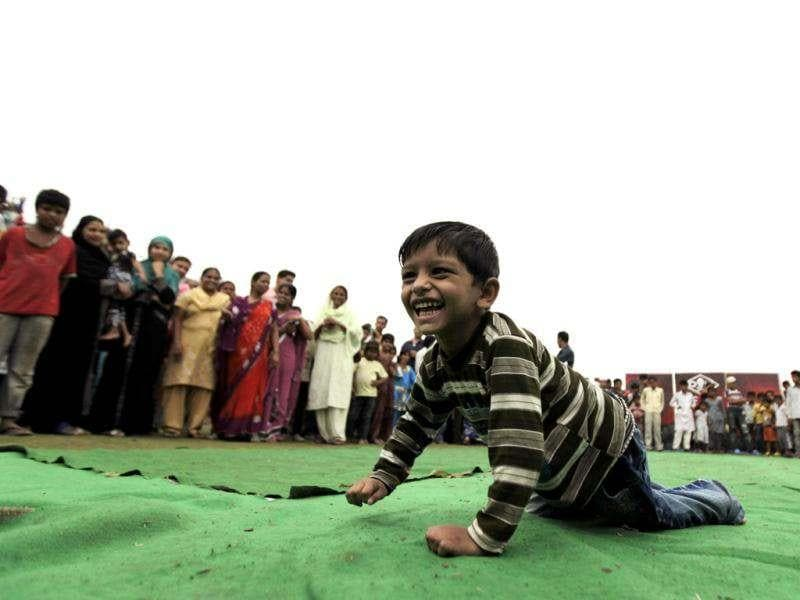A boy suffering with birth defects competes in a crab-walk race during a Special Olympics held by the survivors of the deadly 1984 Bhopal gas leak in an effort to shame Olympic sponsor Dow Chemical Co. on the eve of the London Games in Bhopal. AP photo/Altaf Qadri