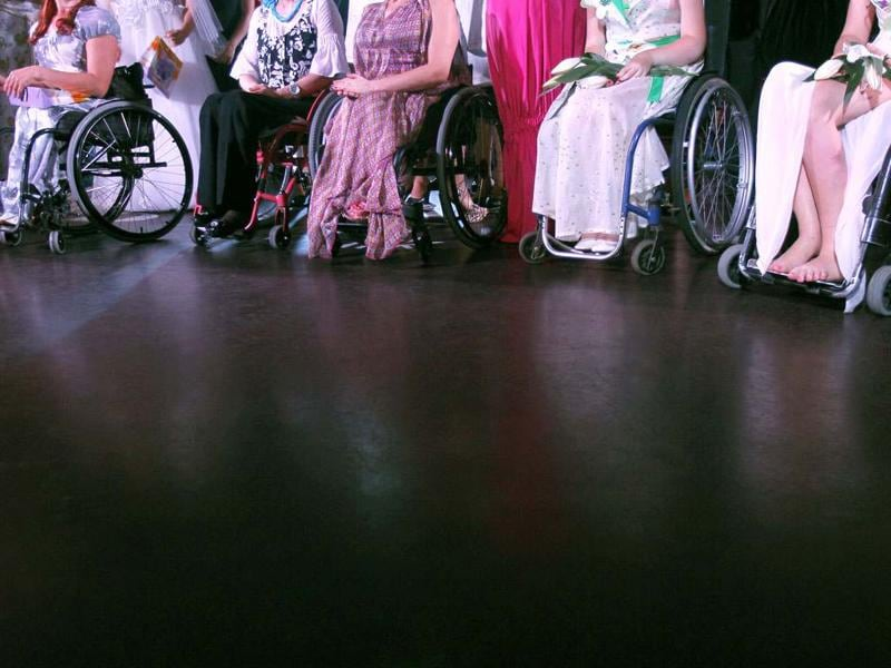 Models with physical disabilities take part in a