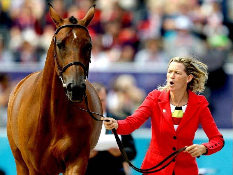 Karin Donckers, of Belgium, and her horse Gazelle de la Brasserie run during a horse inspection for the equestrian eventing competition at the 2012 Summer Olympics in London. (AP Photo/David Goldman)