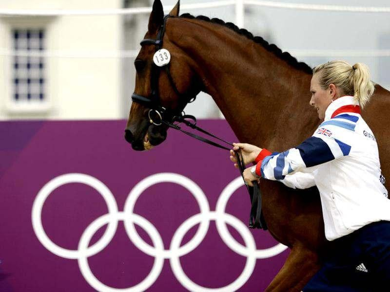 Great Britain's Zara Phillips and her horse High Kingdom run during a horse inspection for the equestrian eventing competition at the 2012 Summer Olympics in London. (AP Photo/David Goldman)
