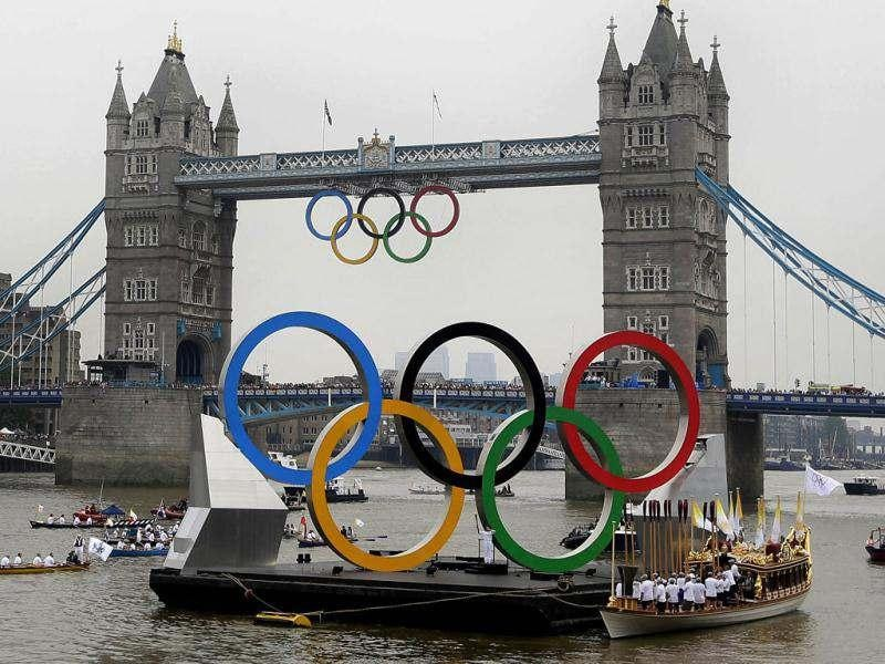 The royal barge Gloriana carries the Olympic flame along the river Thames on the final day of the Torch Relay in London. (AP Photo/Kirsty Wigglesworth)