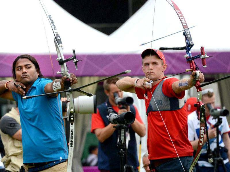 Indian archer Jayanta Talukdar (L) during a training session prior to the ranking round of the men's archery individual event at the Olympic Games 2012 in London. (PTI Photo/Manvender Vashist)