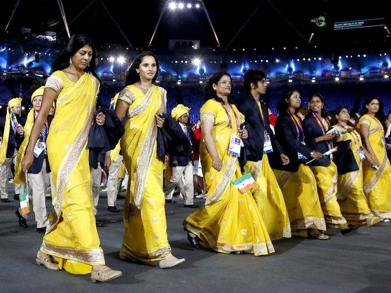 Sania Mirza of India, second from left, parades with fellow athletes during the Opening Ceremony at the 2012 Summer Olympics in London. (AP Photo)