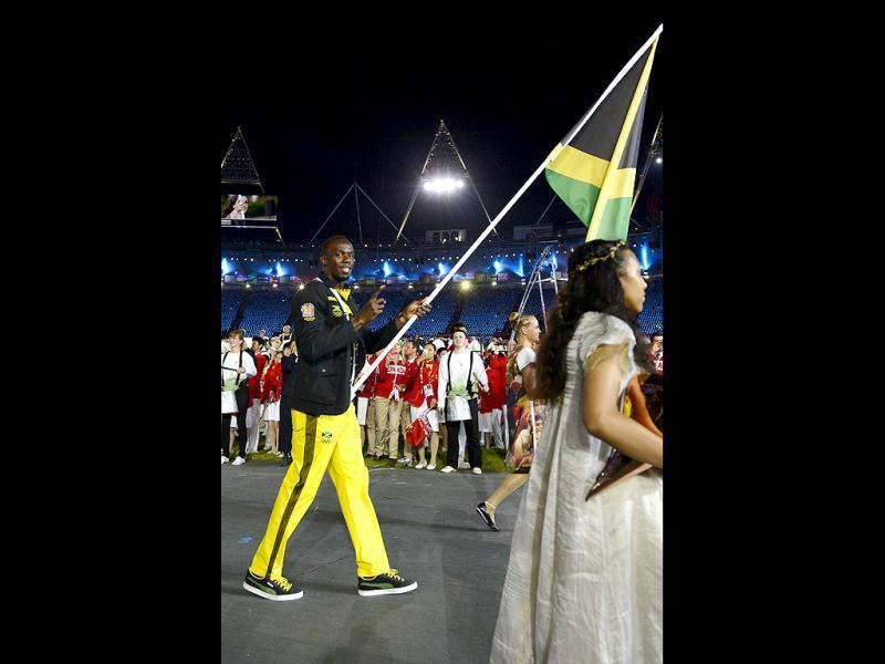 Jamaica's flagbearer Usain Bolt leads his country's delegation during the opening ceremony of the London 2012 Olympic Games at the Olympic stadium in London. (AFP Photo)