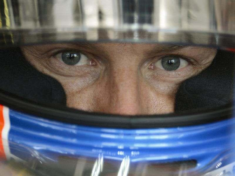 Australia's Red Bull driver Mark Webber waits for his second practice session of the Hungarian Formula One Grand Prix at the Hungaroring circuit outside Budapest, Hungary. The circuit will host the Hungarian Formula One Grand Prix. (AP Photo)
