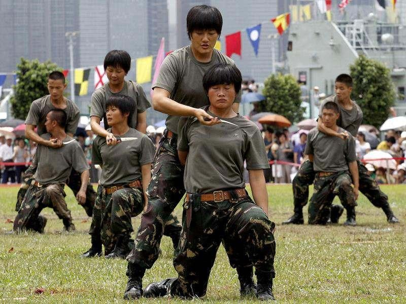 Chinese People's Liberation Army (PLA) soldiers present a martial arts demonstration during an open day at the Ngong Shuen Chau Naval Base on Hong Kong's Stonecutters Island. (Reuters)