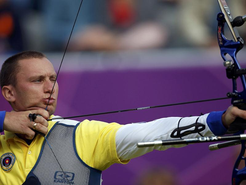 Ukraine's Ruban Viktor takes aim during the men's archery team eliminations at the Lords Cricket Ground during the London 2012 Olympics Games. Reuters/Suhaib Salem
