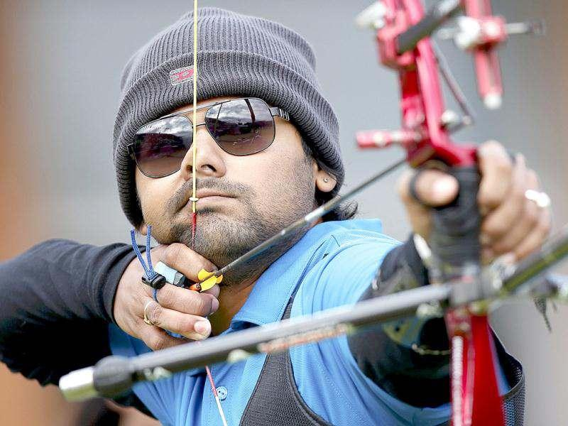 Rahul Banerjee takes aim during the men's archery team eliminations at the Lords Cricket Ground during the London 2012 Olympics Games July 28, 2012. Reuters/Suhaib Salem