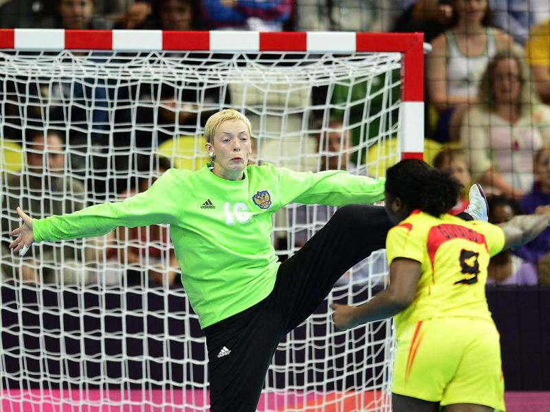 Russia's goalkeeper Maria Sidorova vies with an Angolan player during the women's preliminaries Group A handball match Russia vs Angola for the London 2012 Olympics Games at the Copper Box hall in London. AFP/Javier Soriano
