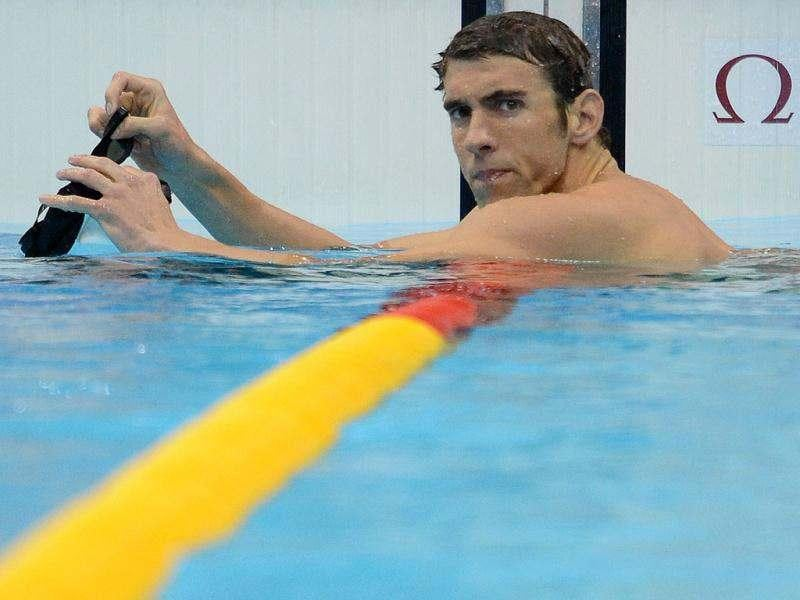 US swimmer Michael Phelps looks on after competing in the men's 400m individual medley heats swimming event at the London 2012 Olympic Games in London. AFP/Martin Bureau