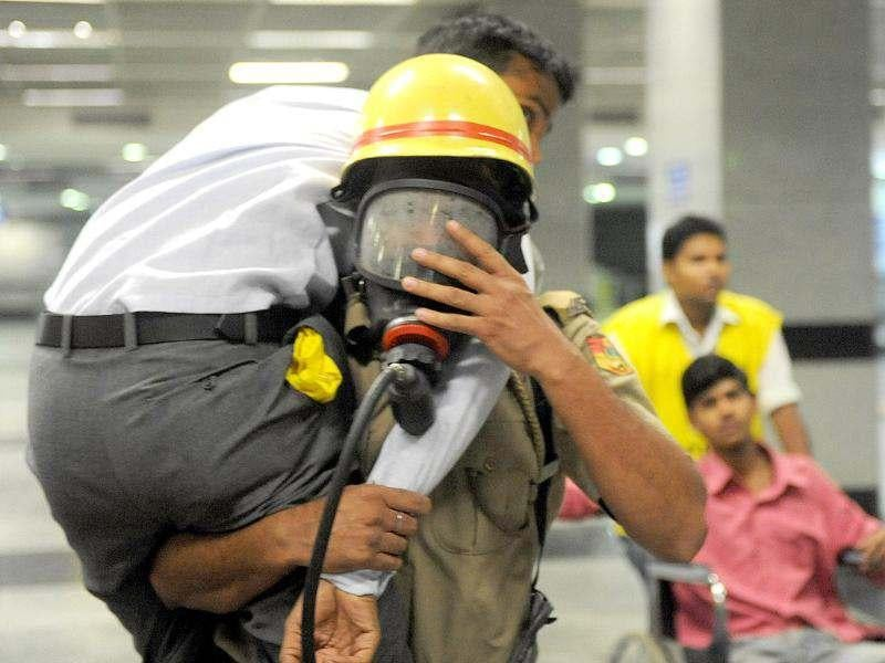 Officers from the National Disaster Response Force (NDRF) attend to a wounded passenger on a train platform during a mock drill conducted by the Delhi Police and Delhi metro authorities involving 12 metro stations in New Delhi. Hundreds of people in the capital took part in a mass emergency drill as mock incidents like bomb blasts, strong earthquakes and terrorist strikes were enacted to check the response mechanism of authorities. AFP/Raveendran