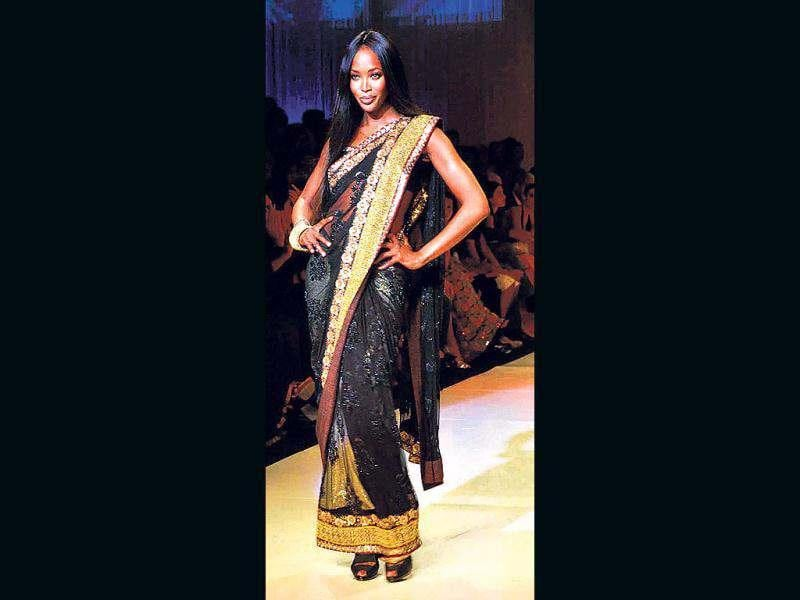 Naomi Campbell dazzles in a black sari.