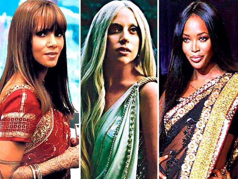Halle Berry is seen wearing a bright red sari, a nose pin, red glass bangles and mehndi on her hands in Cloud Atlas. Here's a look at other Hollywood hotties who are in love with this six-yard Indian wonder.