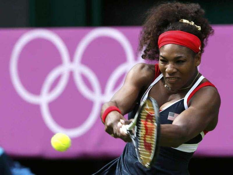 Serena Williams of the United States returns to Jelena Jankovic of Serbia in their women's singles tennis match at the All England Lawn Tennis Club during the London 2012 Olympics Games. Reuters/Stefan Wermuth