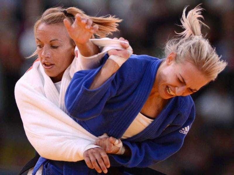 Hungary's Eva Csernoviczki (R) competes with Belgium's Charline Van Snick during their women's -48 kgs contest match of the judo event at the London 2012 Olympic Games on July 28. AFP/Johannes Eisele