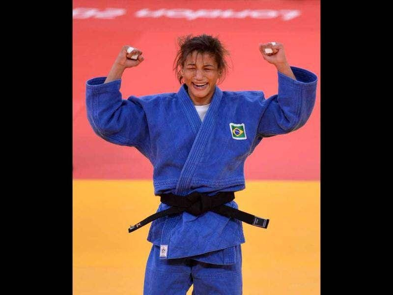Brazil's Sarah Menezes (blue) celebrates as she wins against Romania's Alina Dumitru during their women's -48 kgs contest final match of the judo event at the London 2012 Olympic Games. AFP/Johannes Eisele