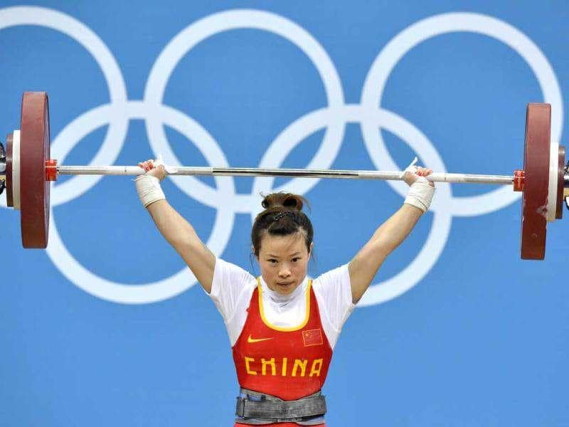 China's Wang Mingjuan lifts during the women's 48kg group A weightlifting competition at The Excel Centre in London during the 2012 Olympic Games. AFP/Yuri Cortez