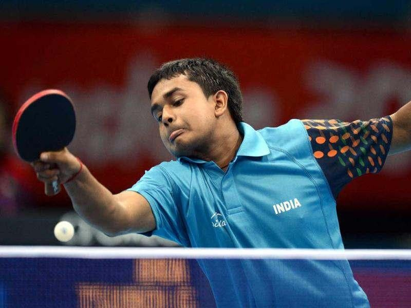 Indian paddler Soumyajit Ghosh serves to Brazil's Gustavo Tsuboi during a table tennis men's singles preliminary round match of the London 2012 Olympic Games at the Excel centre in London. AFP/Saeed Khan