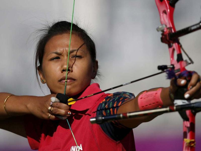 India's Bombayla Devi Laishram takes aim in the women's archery team eliminations at the Lords Cricket Ground during the London 2012 Olympic Games. (Reuters/Suhaib Salem)