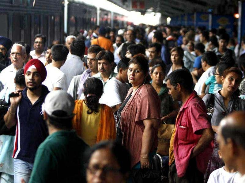 Stranded passengers wait for power to get restored at New Delhi railway station in New Delhi. AP Photo/Rajesh Kumar Singh