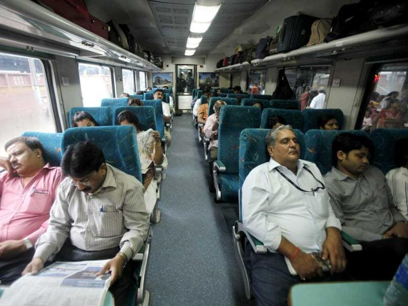 Passengers sit in a train as they wait for power to get restore, at a railway station, in New Delhi. A major power outage struck northern India, plunging cities into darkness and stranding hundreds of thousands of commuters. AP Photo/Rajesh Kumar Singh