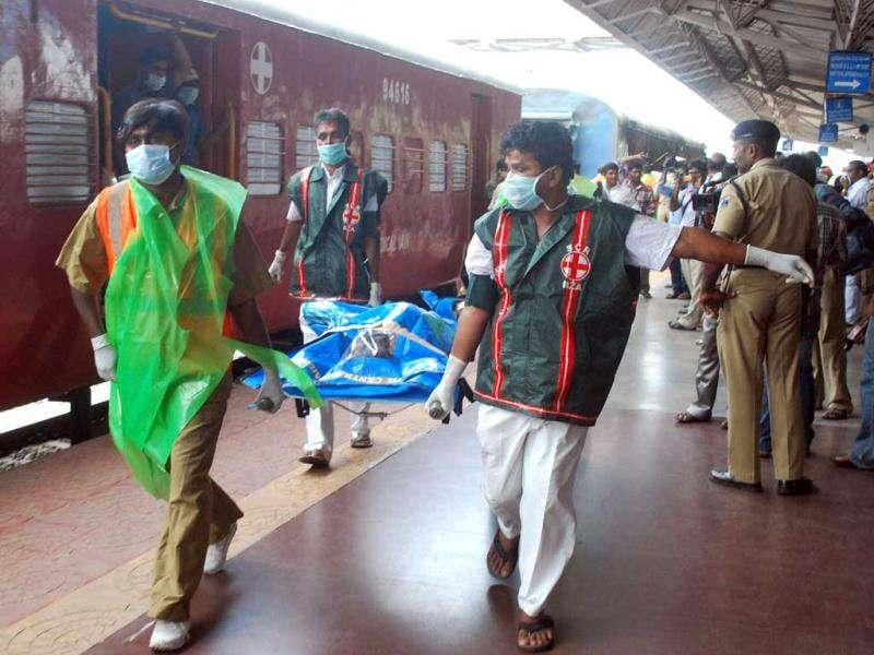 Medical staff carry away the body of a passenger killed in a train carriage fire, caused by an electrical short circuit killing at least 32, in Nellore. AFP photo