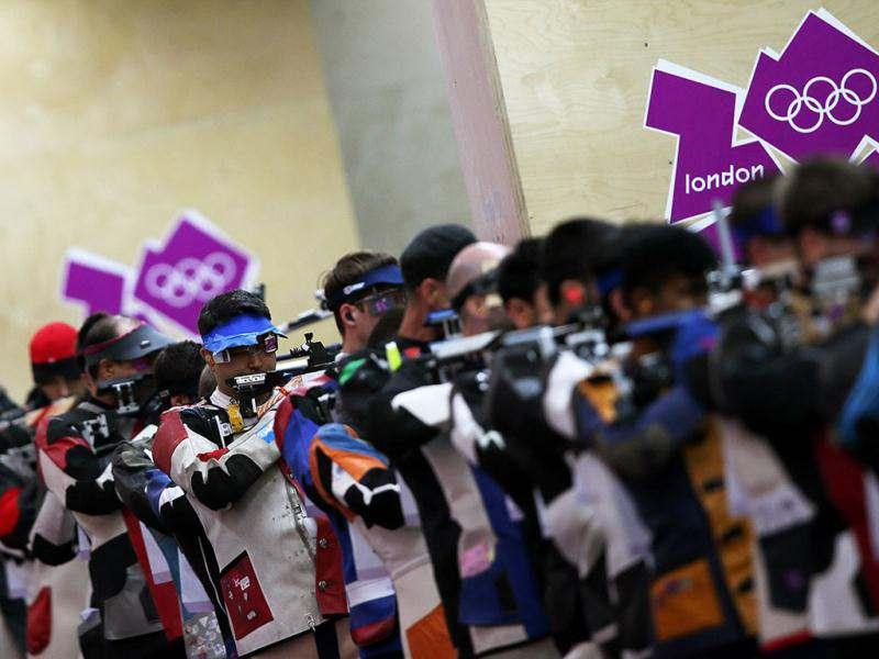 India's Gagan Narang competes in the 10m air rifle men qualifying round at the Royal Artillery Barracks in London during the London 2012 Olympic Games. (AFP/Marwan Naamani)