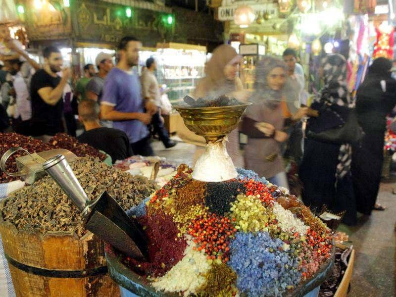 Egyptians walk in front of incense shop at Al-Hussein historical site in Cairo, Egypt. AP Photo/Amr Nabil