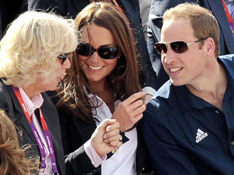 Camilla Parker Bowles, Duchess of Cornwall, Kate Middleton (C), Duchess of Cambridge, and Prince William (R) chat while they wait for Britain's hopeful Zara Phillips compete in the individual equestrian cross country event in the London 2012 Olympic Games. Reuters photo/Olivia Harris