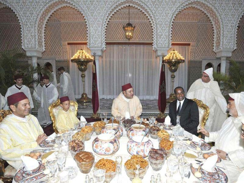 Morocco's King Mohammed VI (C) sits beside his son Crown Prince Moulay Hassan III (2nd L) and his brother Moulay Rachid (L) as they break fast during the tenth day of the holy month of Ramadan, in Rabat. Reuters photo
