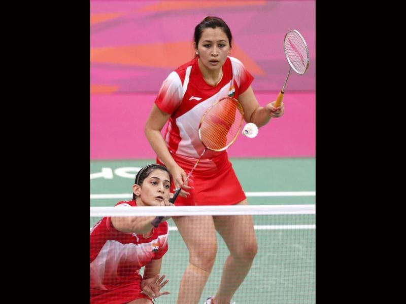 Jwala Gutta and Ashwini Ponnappa play against Taiwan's Cheng Wen-hsing and Chien Yu-chin during their women's doubles group play stage Group B badminton match during the London 2012 Olympic Games at the Wembley Arena. Reuters photo/Bazuki Muhammad