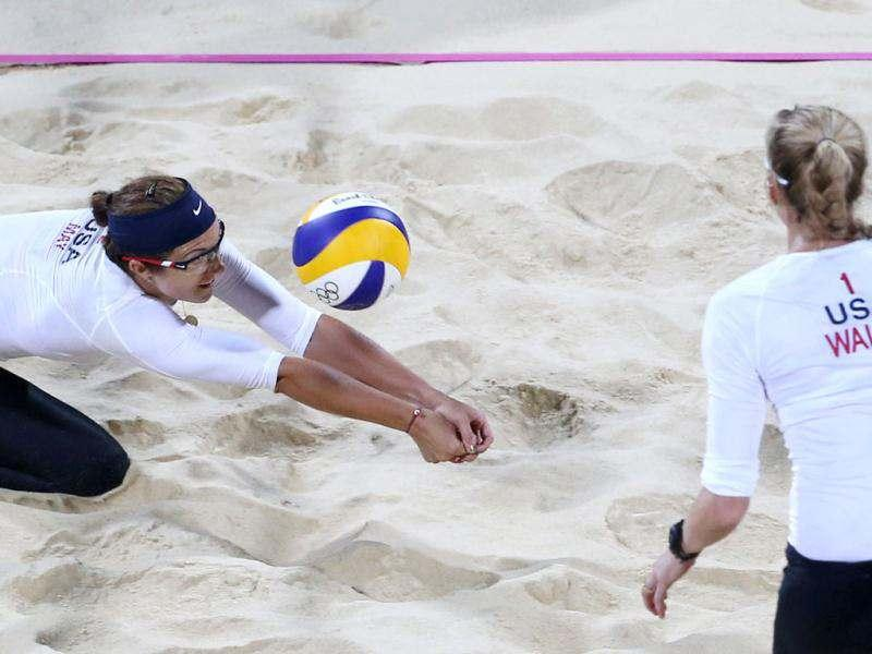 Kerri Walsh, right, of US looks on as her teammate Misty May-Treanor, left, dives for a ball during the Beach Volleyball match against Czech Republic at the 2012 Summer Olympics in London. AP/Petr David Josek