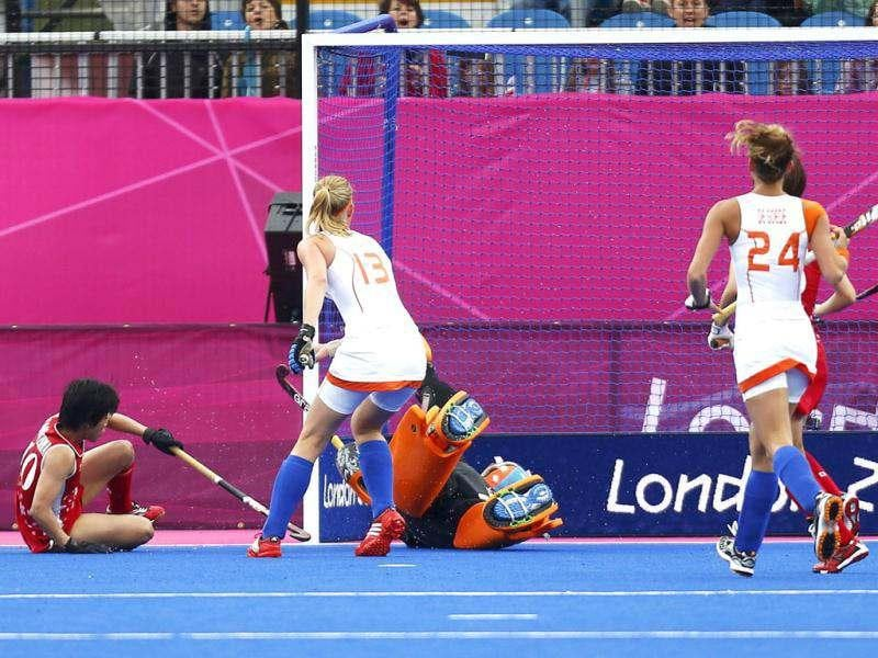 Japan's Rika Komazawa scores a goal during their women's Group A hockey match against Netherlands at the London 2012 Olympic Games at the Riverbank Arena at the Olympic Park. Reuters/Dominic Ebenbichler