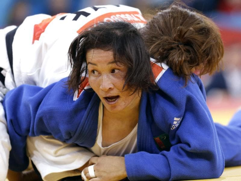 Yoshie Ueno of Japan, top, controls Gartima Chaudhary of India during the women's 63-kg judo competition at the 2012 Summer Olympics in London. AP/Paul Sancya
