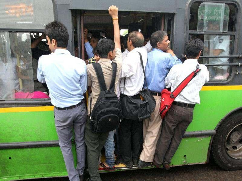 People travel in an overcrowded bus in New Delhi on Tuesday as Metro services were closed following northern grid failure. (AP Photo)