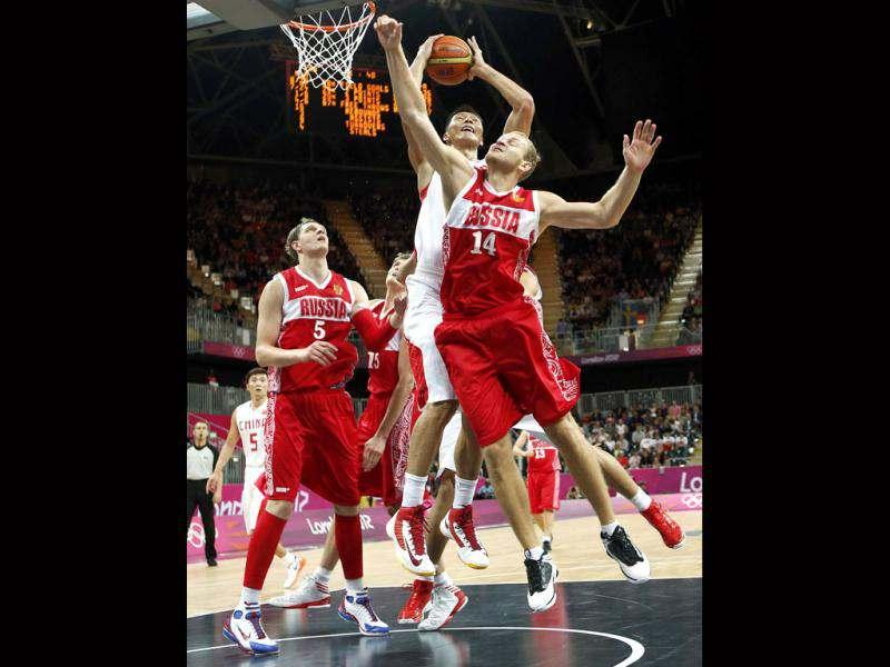 China's Yi Jianlian is challenged by Russia's Timofey Mozgov and Anton Ponkrashov during the men's preliminary round Group B basketball match at the Basketball Arena during the London 2012 Olympic Games. Reuters/Mike Segar