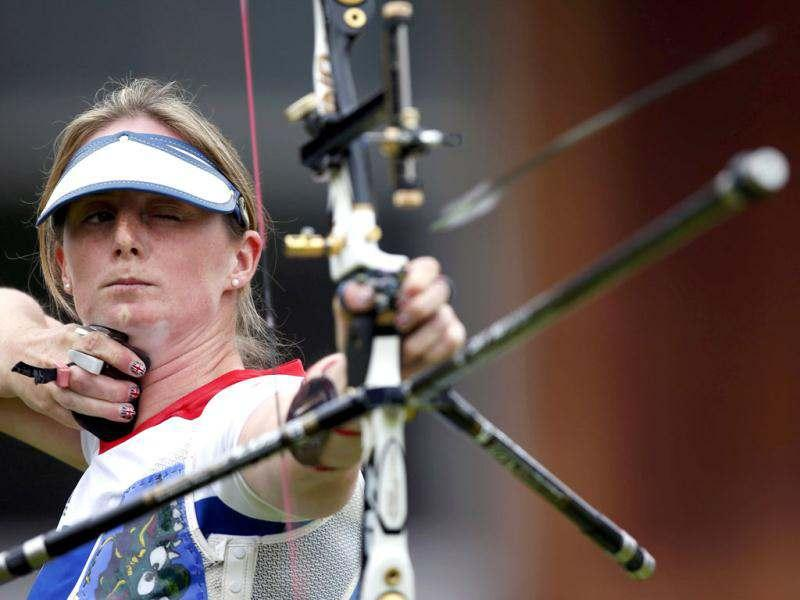 Britain's Naomi Folkard fires and arrow during the women's individual round of 32 eliminations at the Lord's Cricket Ground during the London 2012 Olympic Games. Reuters/Suhaib Salem