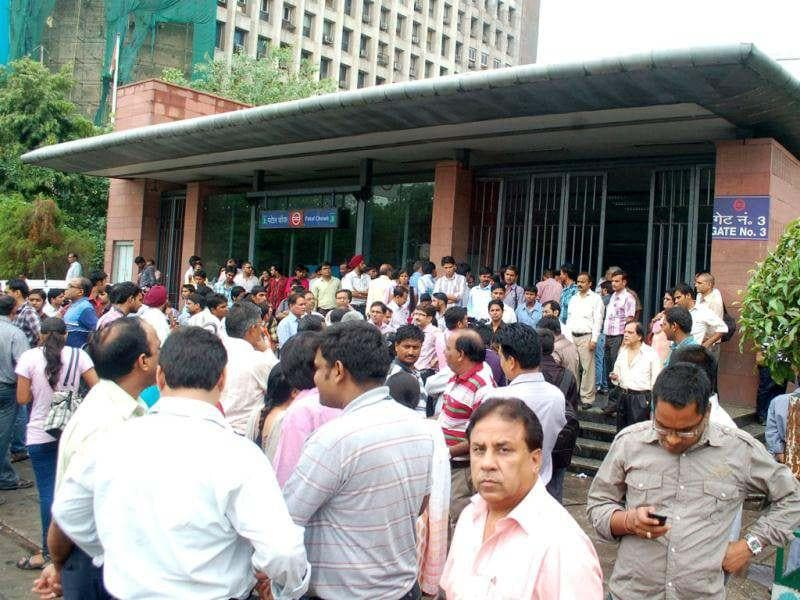 Passengers stranded outside Metro stations in New Delhi following power outage in New Delhi.
