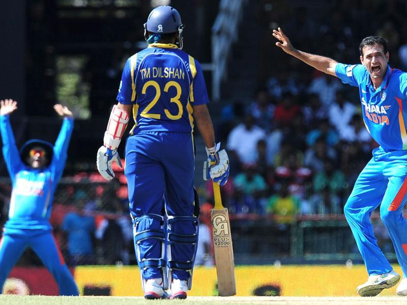 Indian cricketer Irfan Pathan (R) makes an unsuccessful appeal for the wicket of Sri Lankan batsman Upul Tharanga during the fourth one day international (ODI) match between Sri Lanka and India at the R Premadasa Cricket Stadium in Colombo. AFP Photo/Lakruwan Wanniarachchi