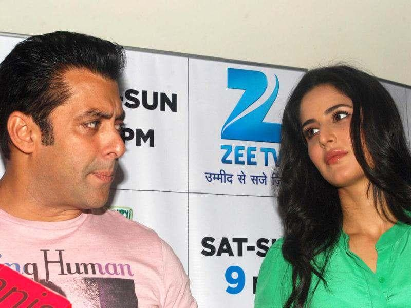 Salman Khan talks to the media while Katrina Kaif gazes at him.