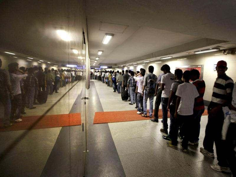 Commuters wait in line at a Metro station after Delhi Metro rail services were disrupted following power outage in New Delhi. India's energy crisis cascaded over half the country when three of its regional grids collapsed, leaving more than 600 million people without government-supplied electricity in one of the world's biggest-ever blackouts. AP/Manish Swarup