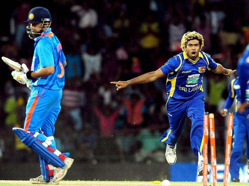 Sri Lankan cricketer Lasith Malinga celebrates after he dismissed Indian cricketer Gautam Gambhir during the fourth one day international (ODI) match between Sri Lanka and India at the R Premadasa Cricket Stadium in Colombo. (AFP Photo/Lakruwan Wanniarachchi)
