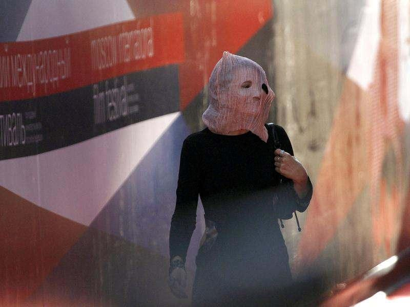 Russian film director Olga Darfy arrives wearing a mask in support of detained members of female punk band Pussy Riot, for the opening ceremony of the 34th International Film Festival in Moscow. Three members of