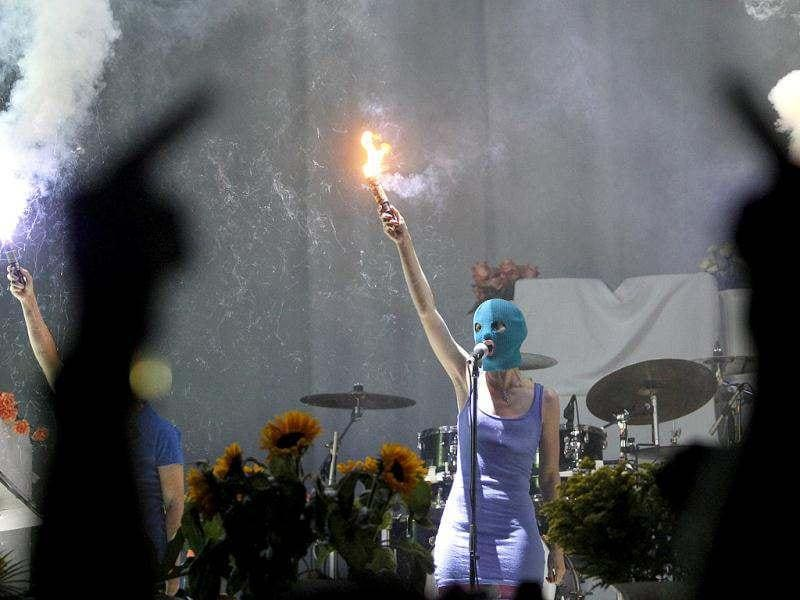 Members of the female punk group Pussy Riot perform during a concert by US rock group Faith No More in Moscow. Three members of