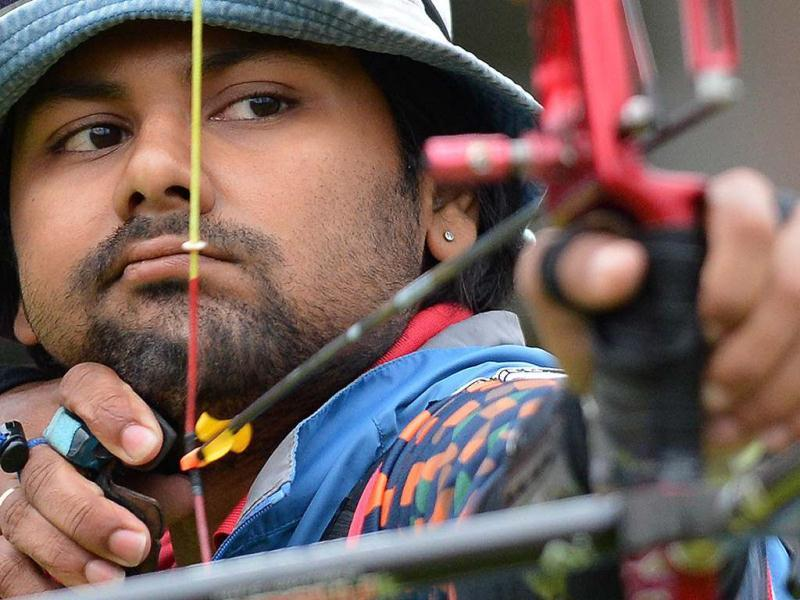 Rahul Banerjee competes in the London 2012 Olympic Games men's individual elimination archery event at Lord's Cricket Ground in London. (AFP Photo/Jewel Samad)